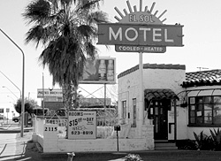 In an effort to attract customers, older motels such as this urban Arizona establishment offer rock-bottom prices for longer term guests, essentially creating low-income housing.